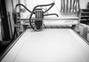 A router cutting out acrylic.