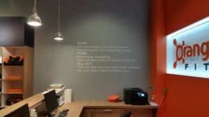 Cut Vinyl on Orange Theory Wall
